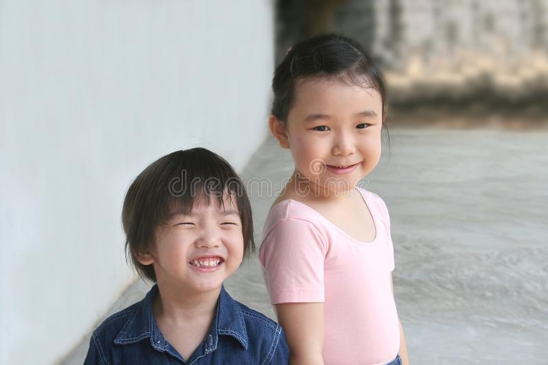 Girl & little boy stock photos