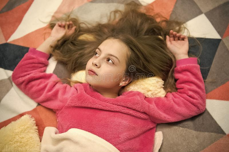 Girl little child relax at home. Evening relaxation before sleep. Child care concept. Pleasant time relaxation. Mental royalty free stock photos