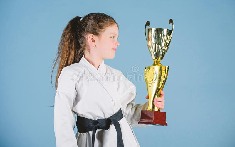 Girl little child in white kimono with belt. Karate fighter child. Karate sport concept. Self defence skills. Karate. Gives feeling of confidence. Celebrate stock images