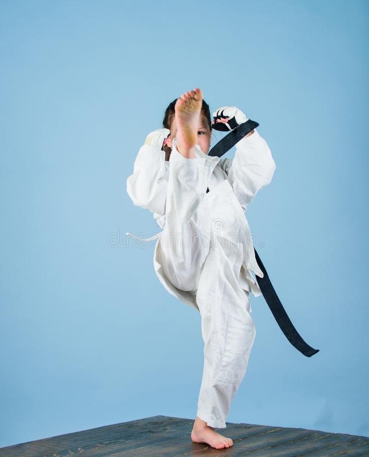Girl little child in white kimono with belt. Karate fighter ready to fight. Karate sport concept. Self defence skills. Karate gives feeling of confidence royalty free stock photo