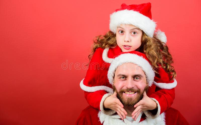 Girl little cute child and bearded father wear santa costume. Christmas party. How to be santa claus parents guide. My. Dad is santa claus. Belief in santa royalty free stock photo