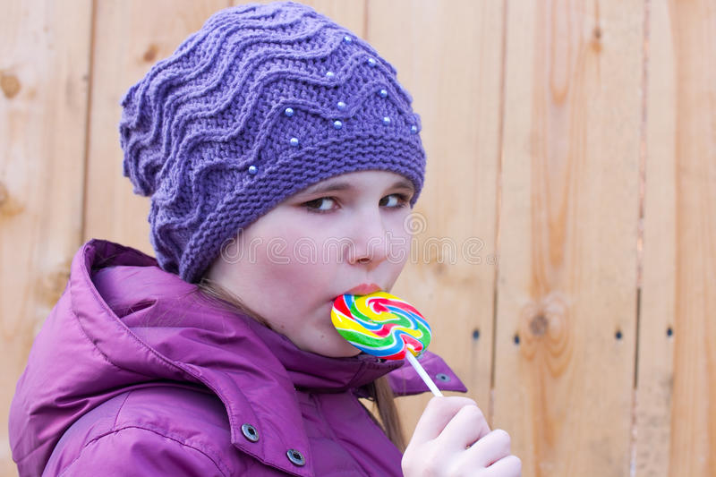 Download Girl and a lollipop stock photo. Image of cheerful, colored - 13651288