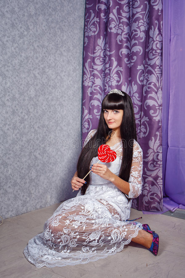 Girl and lollipop stock images