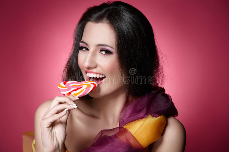 Download Girl with a lollypop stock image. Image of beauty, colored - 20031681
