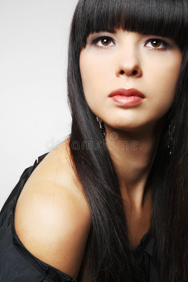 Girl with long black hair. royalty free stock photography