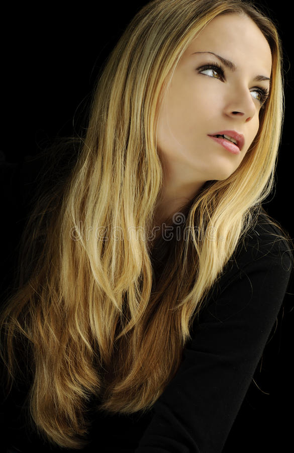 Girl with long blond hair royalty free stock photo