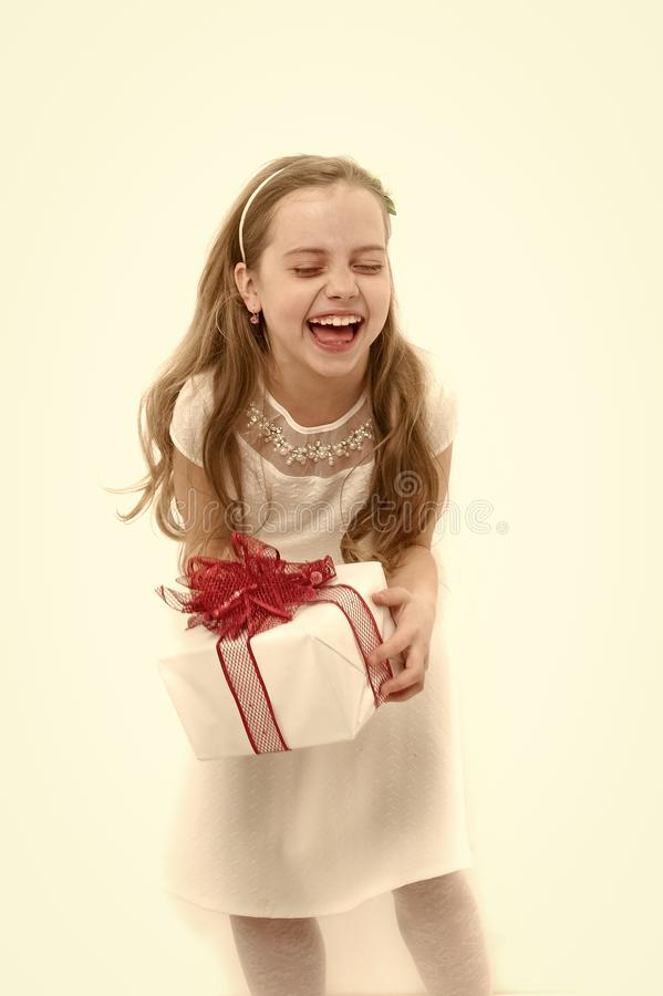 Girl with long blond hair laugh isolated on white. Child hold box with red bow. Birthday, anniversary celebration. Holiday gift, present and surprise. Boxing royalty free stock photos