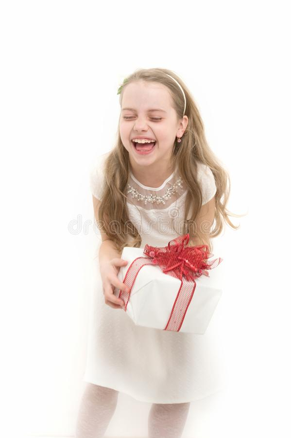Girl with long blond hair laugh isolated on white. Child hold box with red bow. Birthday, anniversary celebration. Holiday gift, present and surprise. Boxing stock images