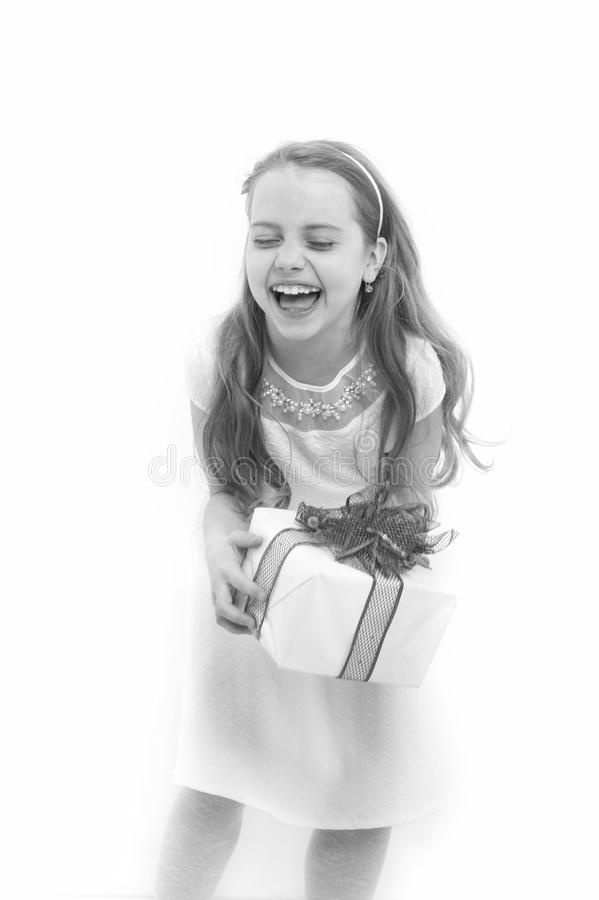 Girl with long blond hair laugh isolated on white. Child hold box with red bow. Birthday, anniversary celebration. Holiday gift, present and surprise. Boxing stock photo