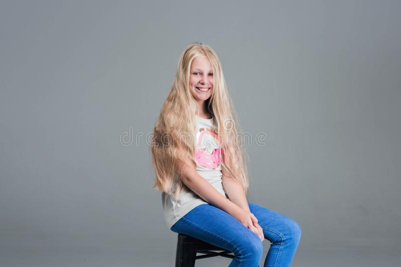 Girl with long hair. The concept, haircut royalty free stock photography