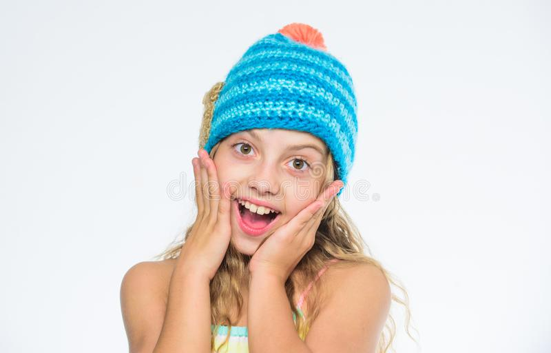 Girl long hair happy face white background. Kid wear warm soft knitted blue hat. Difference between knitting and crochet. Fall winter season accessory. Free royalty free stock images