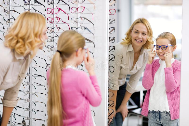 Girl look herself in the mirror with new eyewear royalty free stock photo