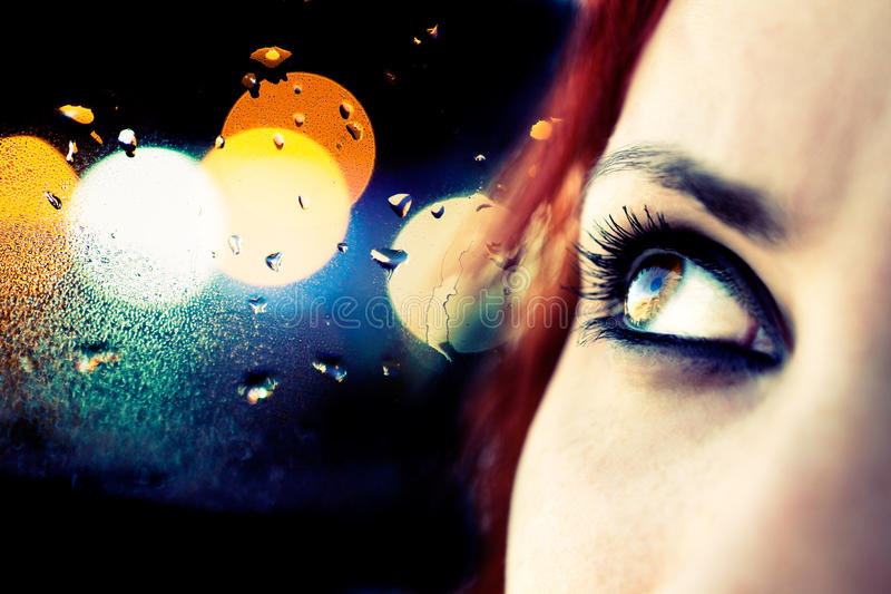 Girl looking. Colorful image detail of girl looking and abstract lights royalty free stock photo