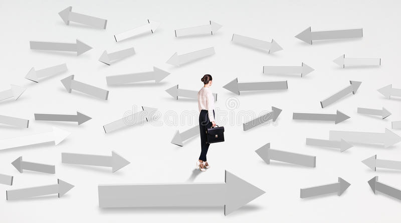 Girl looking at arrows stock images