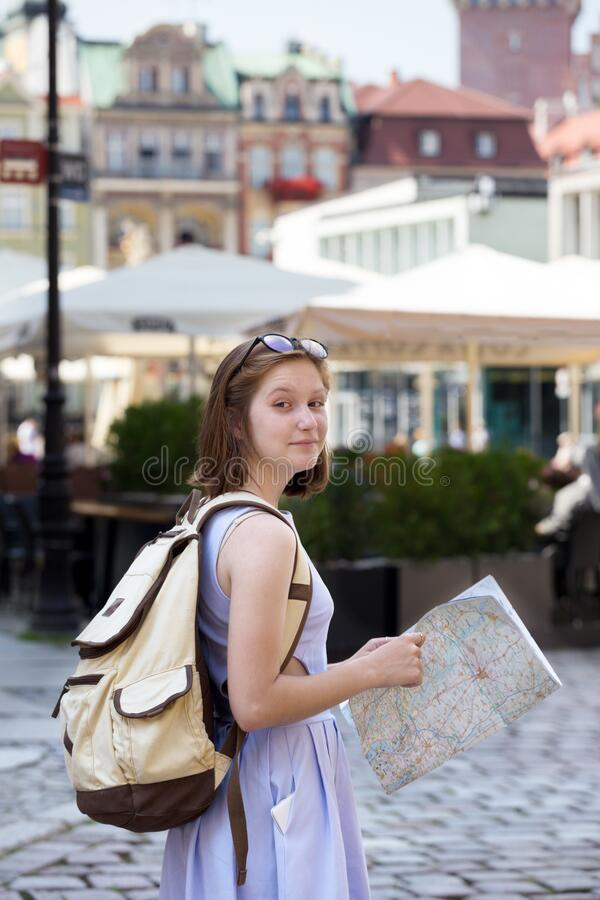 Free Girl Looking At The Map Standing At The Main Square Royalty Free Stock Image - 181216146