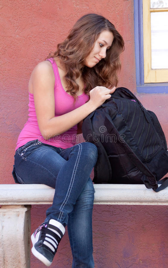 Download Girl looking in backpack stock photo. Image of female - 28130518