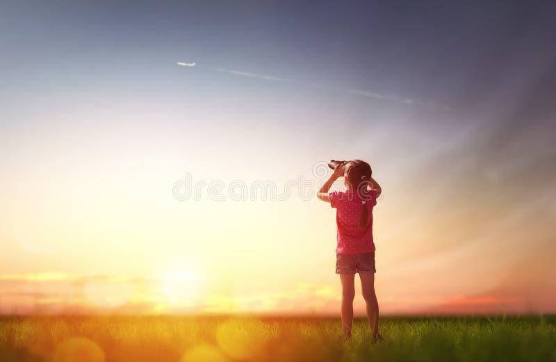 Girl looking through binoculars royalty free stock images