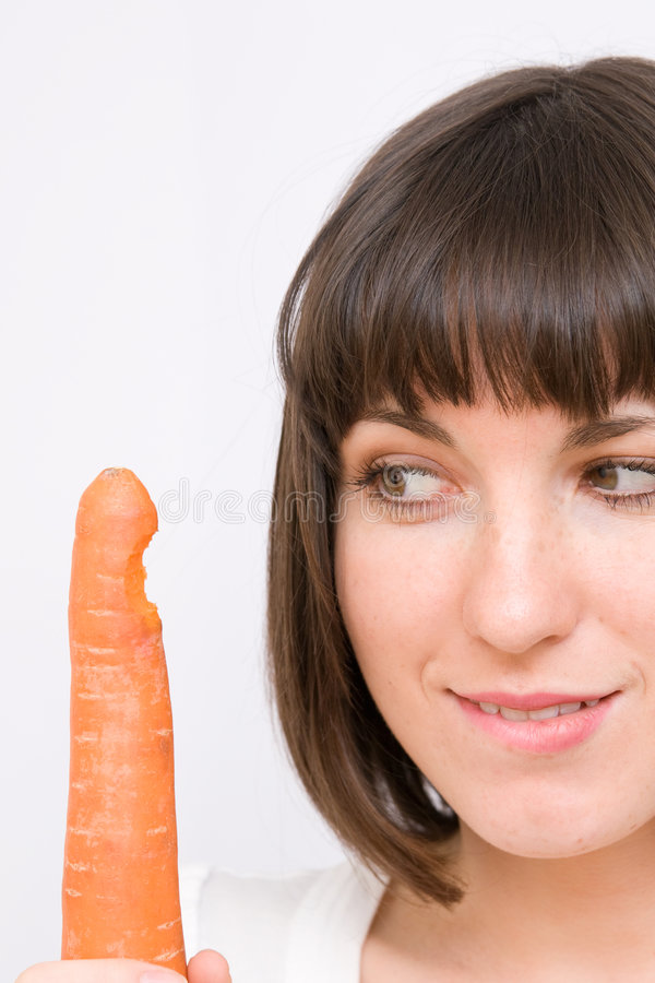 Girl looking at carrot stock images