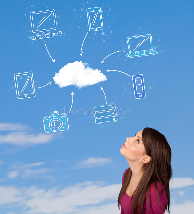 Girl looking at cloud computing concept on blue sky. Casual young girl looking at cloud computing concept on blue sky stock photos