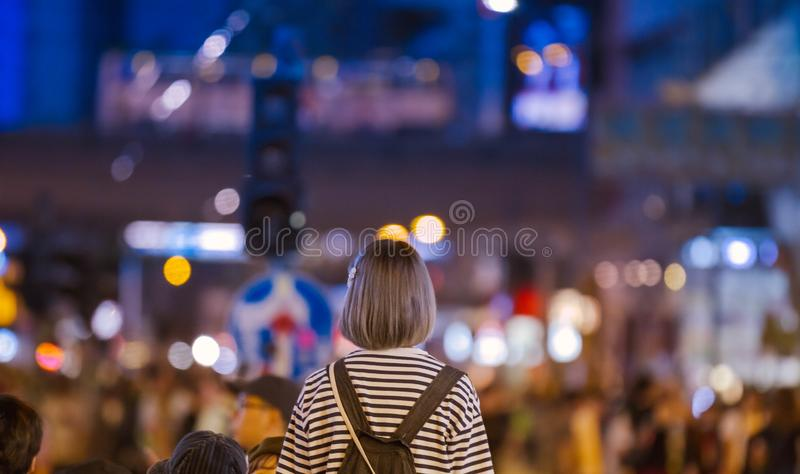 Girl looking intot the distant city stock photography