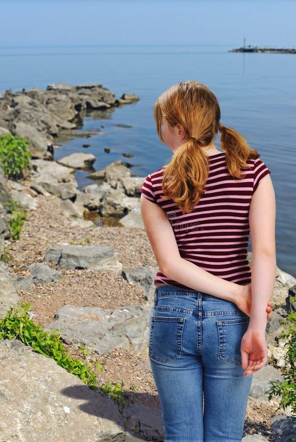 Girl Looking at Lake royalty free stock photography