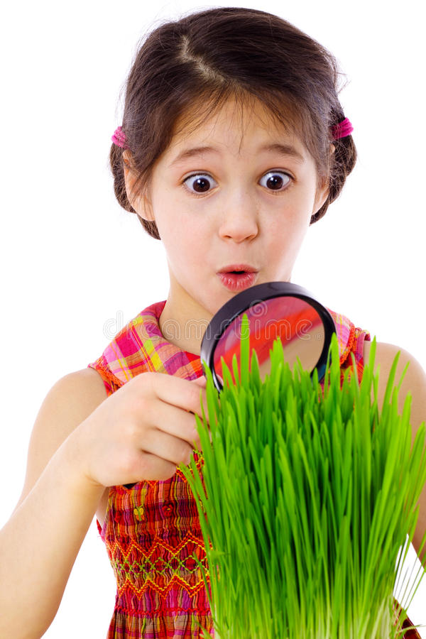 Download Girl Looking Through A Magnifier At The Grass Stock Image - Image: 24125961