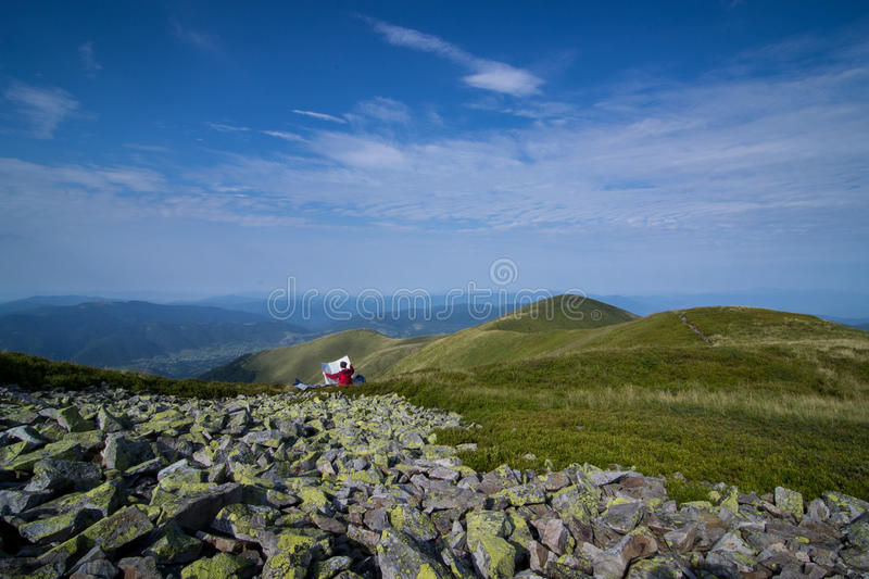 A girl looking into the map. Carpathians, Ukraine. royalty free stock images