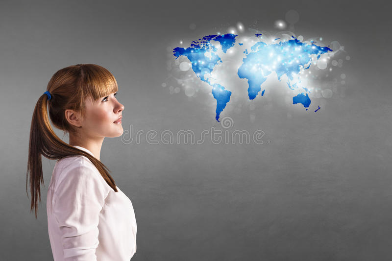 Girl looking at a map royalty free stock images