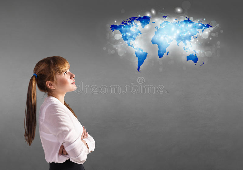 Girl looking at a map stock images