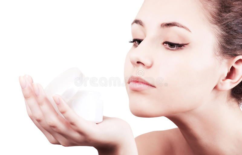 Download Girl Is Looking At Moisturizer Cream. Stock Image - Image: 19125545