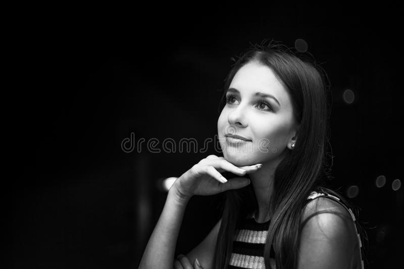 Girl looking at the moon at night, city view, black and white photo royalty free stock photo
