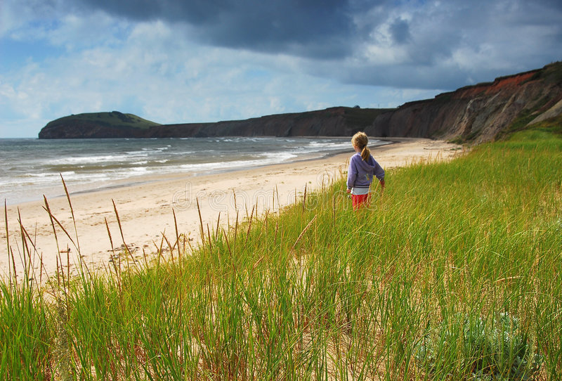 Download Girl Looking Out To Sea stock photo. Image of beach, rocks - 1542066