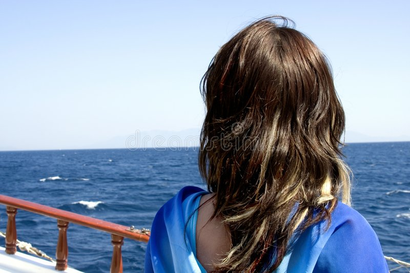 Girl looking out to sea stock photos