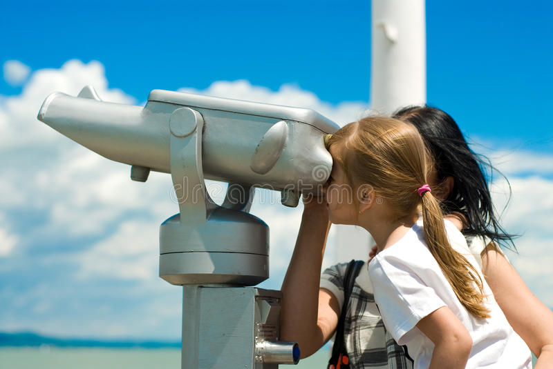 Girl Looking Through Pay-to-use Telescope Stock Images