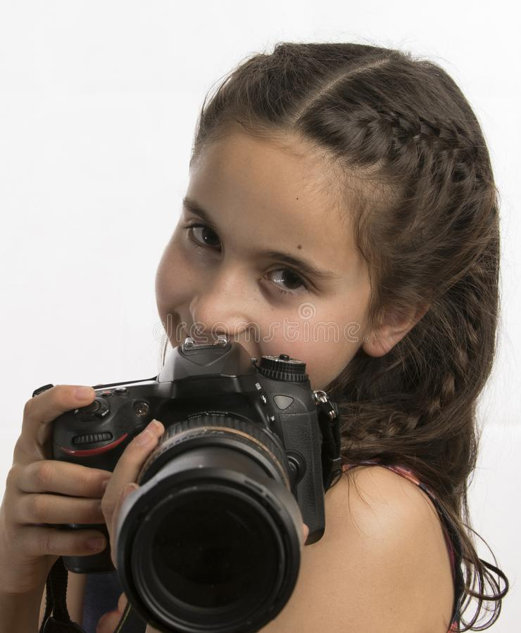 Little girl with a professional camera royalty free stock image