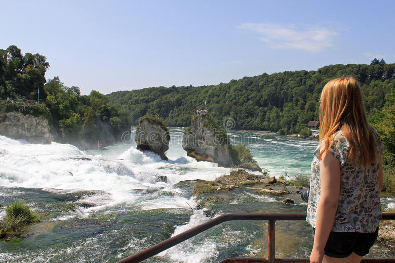 Download Girl Looking At The Rhine Falls In Switzerland Stock Image - Image: 20984137