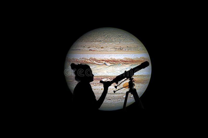 Girl looking at the stars with telescope. Jupiter planet royalty free stock photo