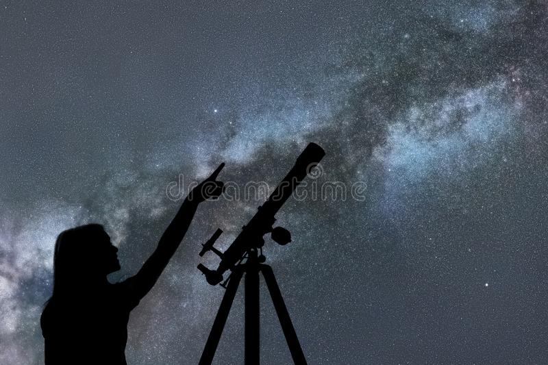 Girl looking at the stars. Telescope Milky Way royalty free stock photography