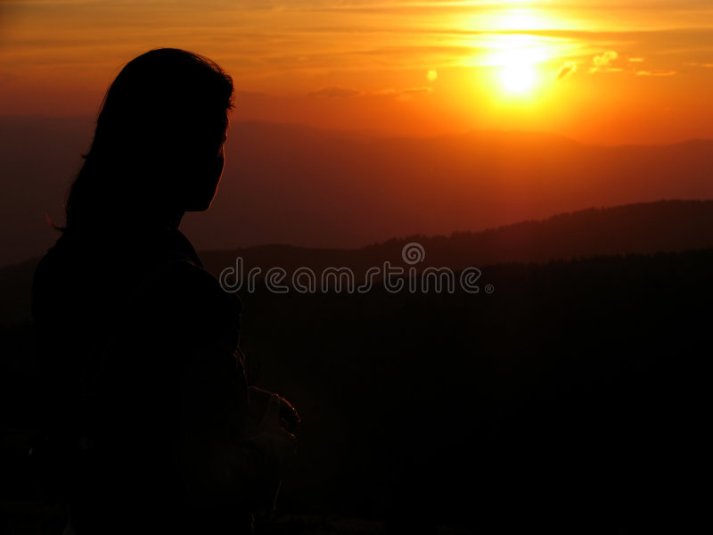 Girl looking at the sunset stock photos