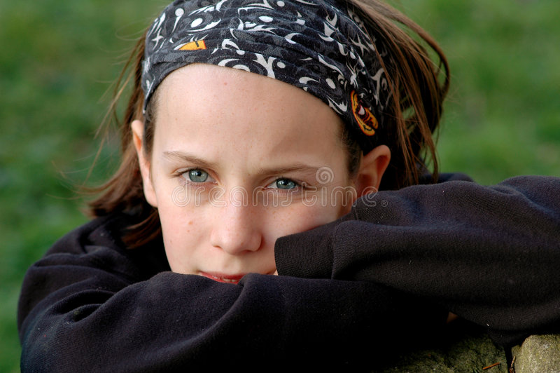 Girl looking thoughtful. Close-up portrait of girl, nikon d70 stock photo