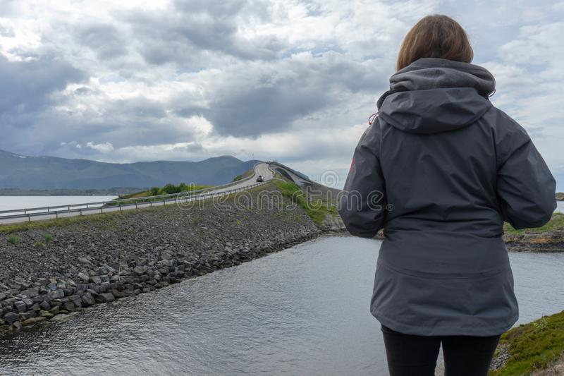 Girl looking towards the atlantic road in Molde/Norway. stock images
