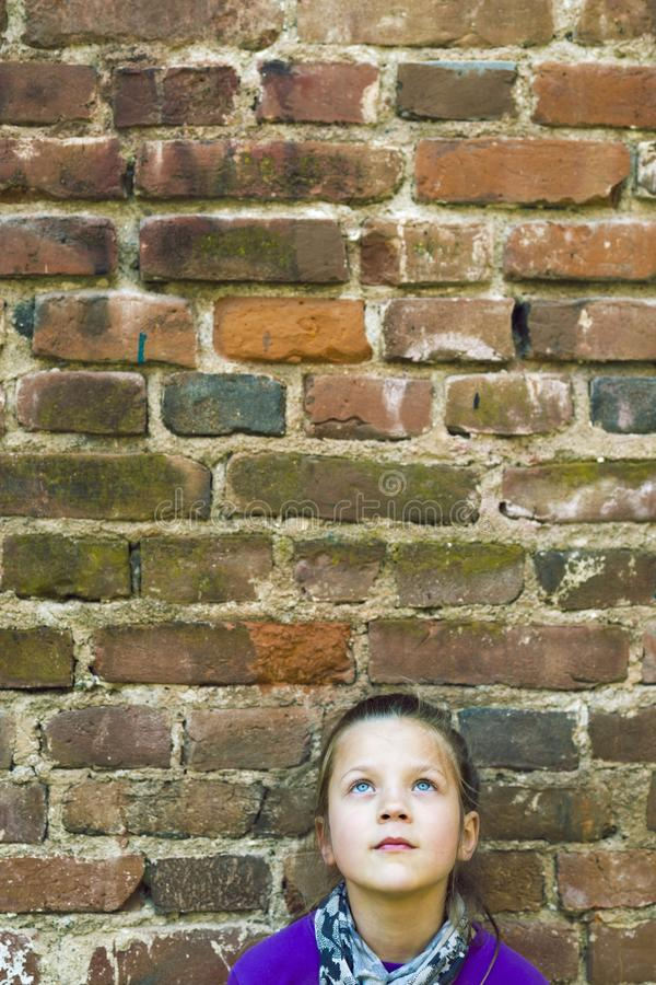Girl looking up wall stock image