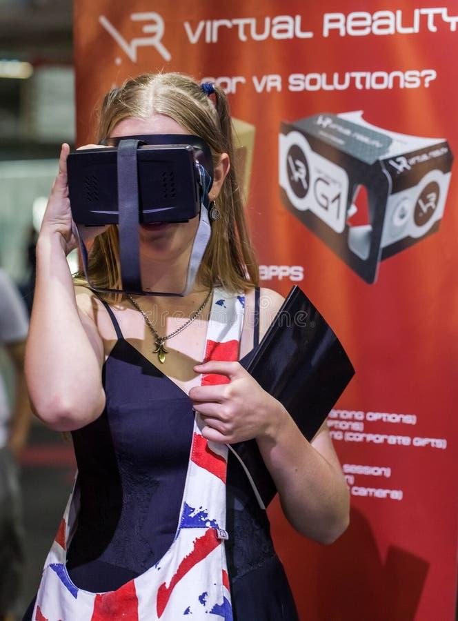 Girl looking through virtual reality headset royalty free stock image