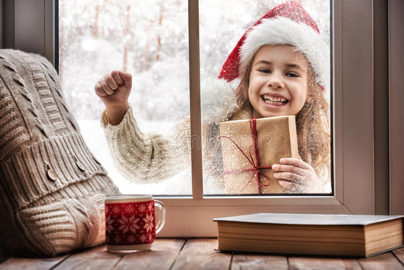 Girl looking in window royalty free stock photography
