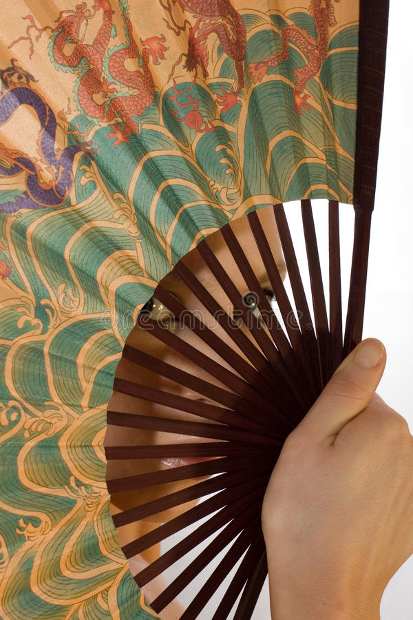 Download Girl Looks Through A Chinese Fan Stock Image - Image: 22745309