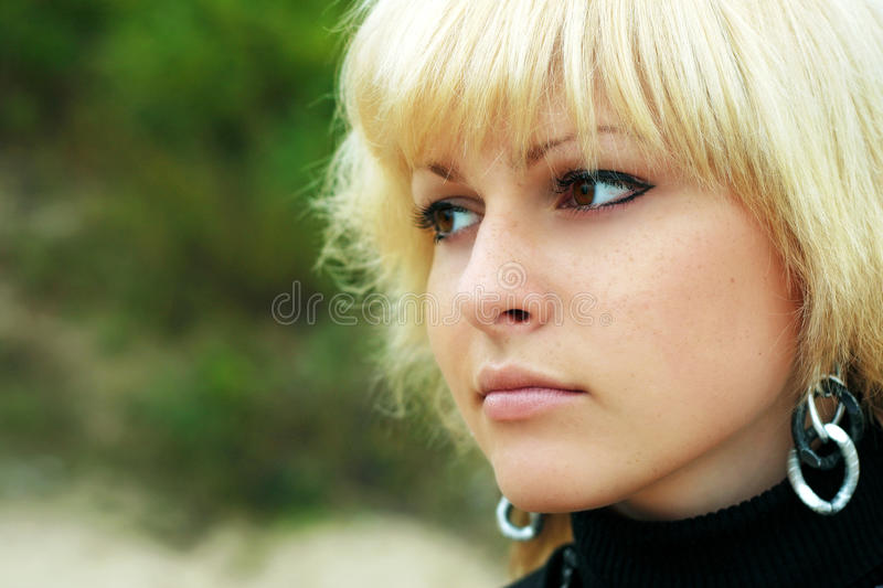 A girl looks in distance royalty free stock photography