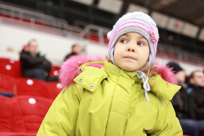 Girl Looks After Game Of Favourite Hockey Command Stock Photography