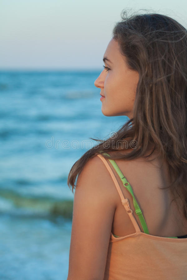 Girl looks at the sea royalty free stock photography