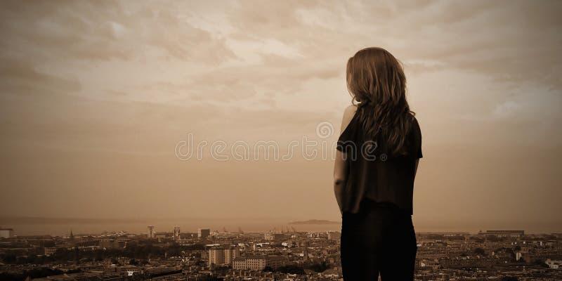 A girl over the city of Edinburgh city stock image