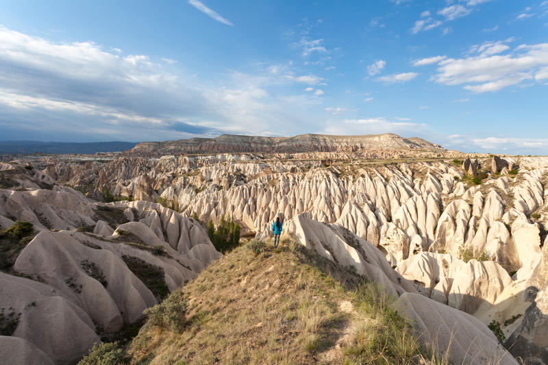 The girl looks at the wonderful landscape of Cappadocia in Turkey, near Goreme. Pink and Red Valley royalty free stock photo